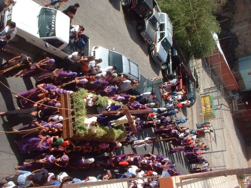 "After the truck that carries the chorus and the priest, the image of Jesus Christ is carried by the group of ""Cargadores"", (the men who carries)"